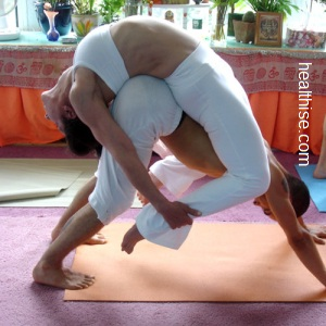 partner yoga couple positions - Double Standing Forward Bend