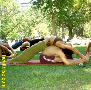 partner yoga couple positions -Practicing Boat pose