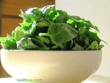 make spinach into a paste and apply on the forehead