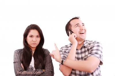 pretend to ignore her - answer it in a disinterested voice