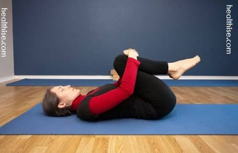 knee to chest pose treatment of indigestion